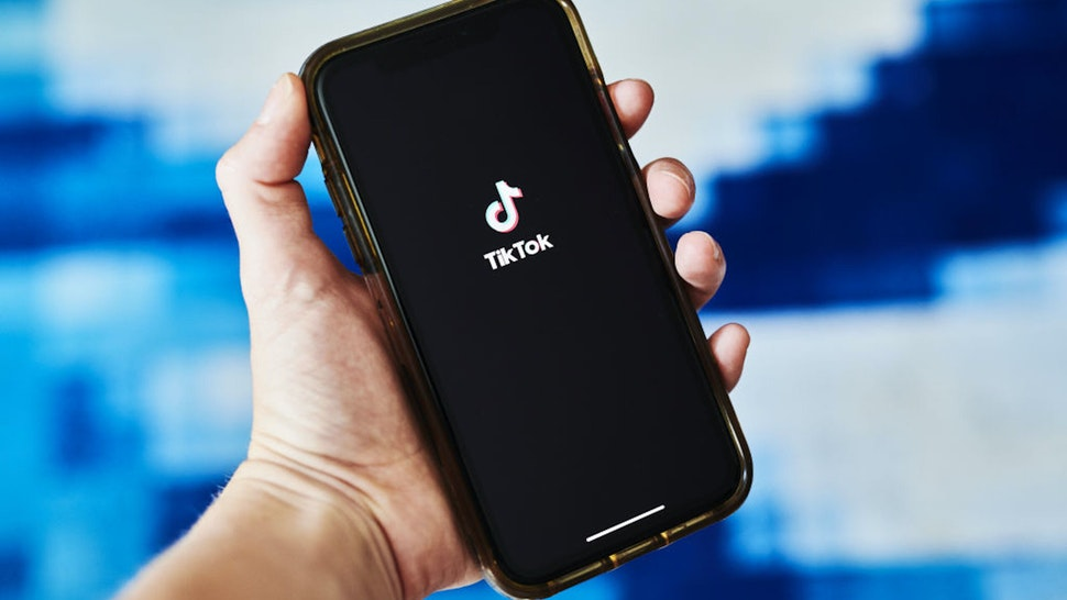 Signage for ByteDance Ltd.'s TikTok app is displayed on a smartphone in an arranged photograph taken in the Brooklyn borough of New York, U.S., on Tuesday, June 30, 2020. India's unprecedented decision to ban 59 of China's largest apps is a warning to China's tech giants, who for years thrived behind a government-imposed Great Firewall that kept out many of America's best-known internet names.