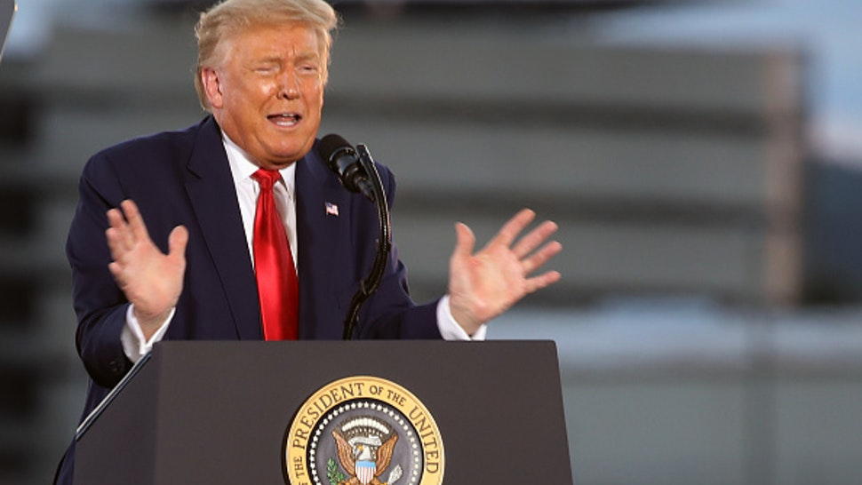 LONDONDERRY, NEW HAMPSHIRE - AUGUST 28: President Donald Trump speaks a rally at an airport hanger on August 28, 2020 in Londonderry, New Hampshire. The rally takes place one day after Trump formally accepted his party's nomination to end the Republican National Convention at the White House. Addressing hundreds of supporters, many wearing face masks, Trump is expected to make the case for his re-election against his opponent Joe Biden.