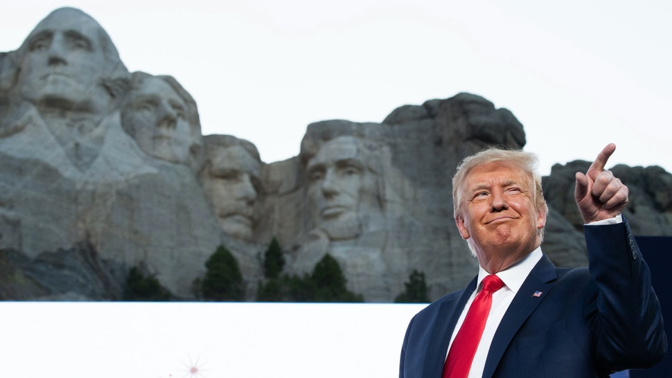 US President Donald Trump gestures as he arrives for the Independence Day events at Mount Rushmore National Memorial in Keystone, South Dakota, July 3, 2020.