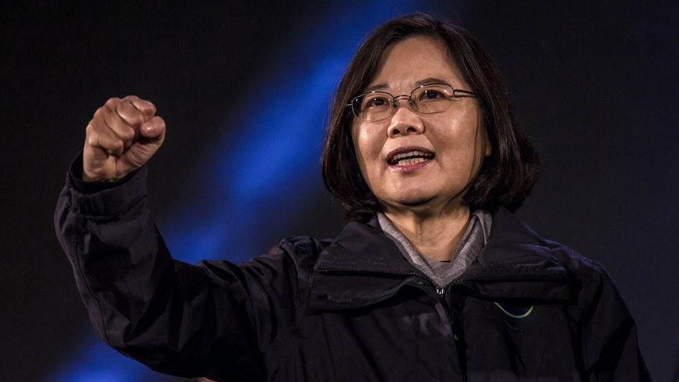 TAIPEI, TAIWAN - JANUARY 15: Democratic Progressive Party (DPP) presidential candidate Tsai Ing-wen waves to supporters during a rally campaign ahead of the Taiwanese presidential election on January 15, 2016 in Taipei, Taiwan. Tsai Ing-wen, leader of the Democratic Progressive Party, leads in most polls ahead of Saturday's election in the island of 23 million people.