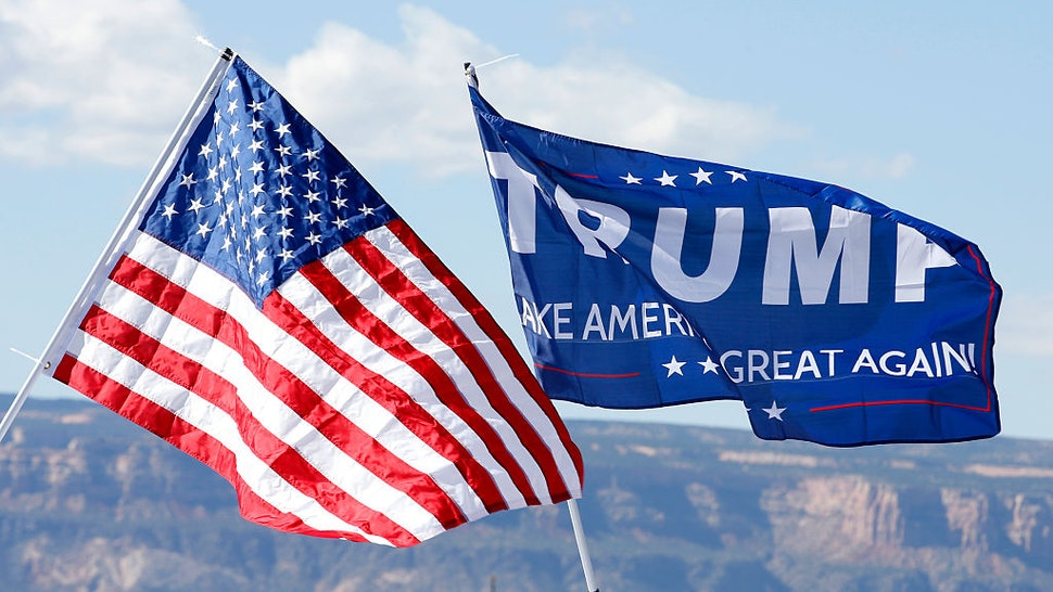 GRAND JUNCTION, CO - OCTOBER 18: With the Colorado National Monument in the background, an American flag and a Trump flag flies at a rally where Republican Presidential Candidate Donald Trump will speak on October 18, 2016 in Grand Junction, Colorado. Trump is on his way to Las Vegas for the third and final presidential debate against Democratic presidential candidate Hillary Clinton. (Photo by George Frey/Getty Images