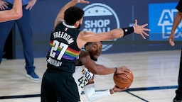 Utah Jazz's Donovan Mitchell (45) is pressured by Denver Nuggets' Jamal Murray (27) during the first half of an NBA basketball first round playoff game, Monday, Aug. 3, 2020, in Lake Buena Vista, Fla.(AP Photo/Ashley Landis, Pool)