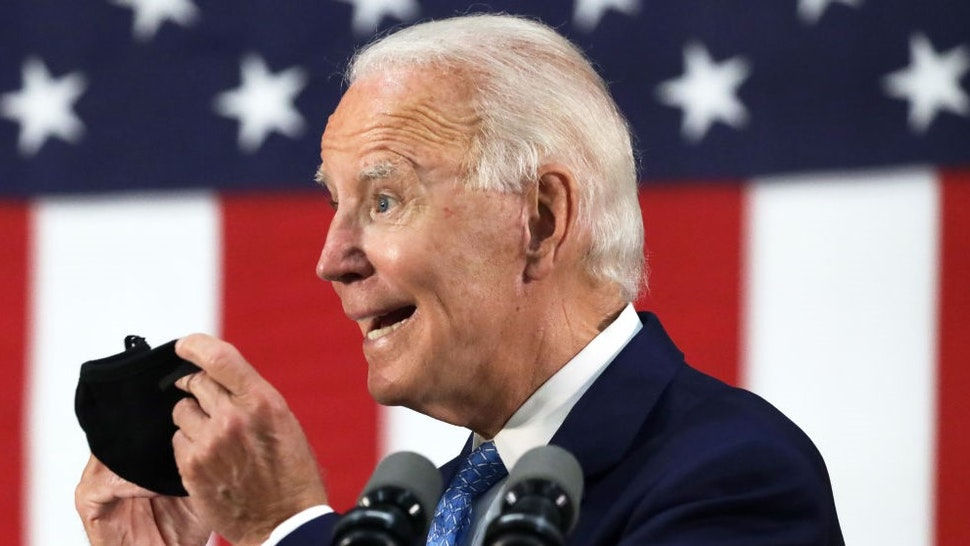 WILMINGTON, DELAWARE - JUNE 30: Democratic presidential candidate, former Vice President Joe Biden holds up a mask as he speaks during a campaign event June 30, 2020 at Alexis I. Dupont High School in Wilmington, Delaware. Biden discussed the Trump Administration's handling of the COVID-19 pandemic. (Photo by