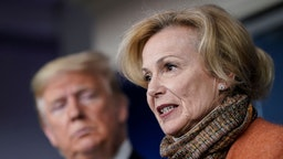 WASHINGTON, DC - MARCH 17: (L-R) U.S. President Donald Trump looks on as White House Coronavirus Response Coordinator Dr. Deborah Birx speaks about the coronavirus outbreak in the press briefing room at the White House on March 17, 2020 in Washington, DC. The Trump administration is considering an $850 billion stimulus package to counter the economic fallout as the coronavirus spreads. (Photo by