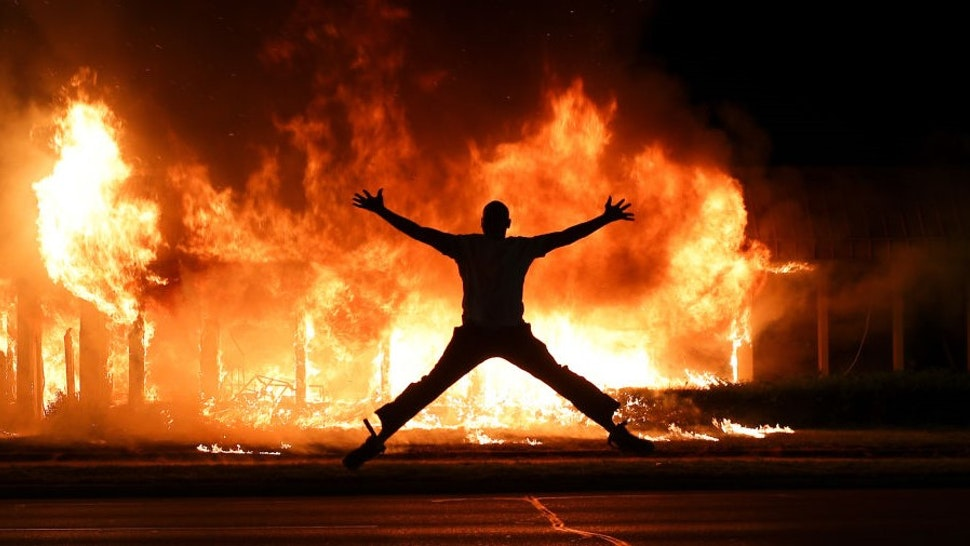 KENOSHA, WISCONSIN, USA - AUGUST 24: Jacob Blake protesters lit buildings on fire in Kenosha, Wisconsin, United States on August 24, 2020. A police shooting in the US state of Wisconsin sent a Black man into serious condition on Sunday, with the video footage of the incident triggering outrage.