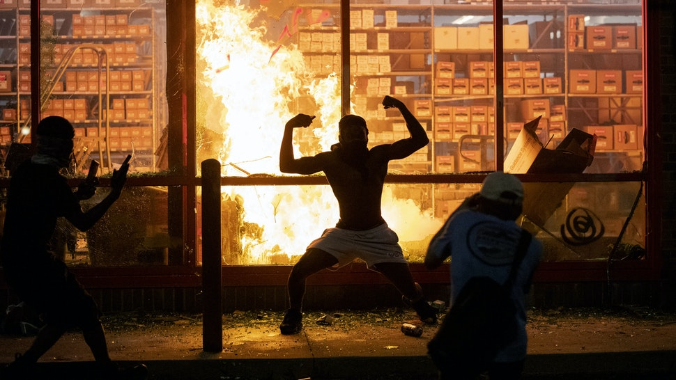 Minneapolis, MN May 27: A fire broke out in an auto parts store across from the Minneapolis police's Third Precinct station Wednesday amid a second night of protest.