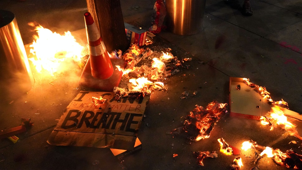PORTLAND, OR - JULY 20: A fire burns around a sign reading I cant breathe during a protest in front of the Mark O. Hatfield U.S. Courthouse on July 201, 2020 in Portland, Oregon. Monday night marked 54 days of protests in Portland following the death of George Floyd in police custody.