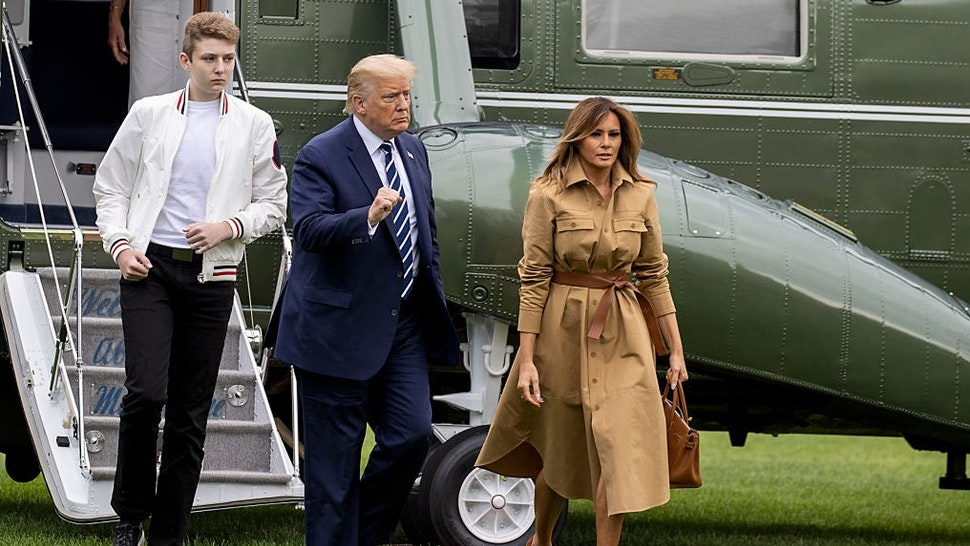 WASHINGTON, DC - AUGUST 16: Barron Trump, US President Donald Trump and First lady Melania Trump walk on the South Lawn of the White House on August 16, 2020 in Washington, DC. Robert Trump, 71, the younger brother ofthe president, died Saturday in Manhattan. (Photo by