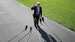 WASHINGTON, DC - MAY 25: U.S. President Donald Trump points up to the second floor of the White House and tells members of the news media that first lady Melania Trump is watching him depart the White House May 25, 2018 in Washington, DC. Trump is traveling to Annapolis, Maryland, to participate in the Naval Academy's graduation ceremony. (Photo by