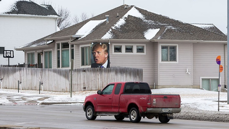 UNITED STATES - JANUARY 26 - A truck drives past a giant poster of Republican presidential candidate Donald Trump in supporter George Davey's backyard in West Des Moines, Iowa, Tuesday, January 26, 2016. (Photo By