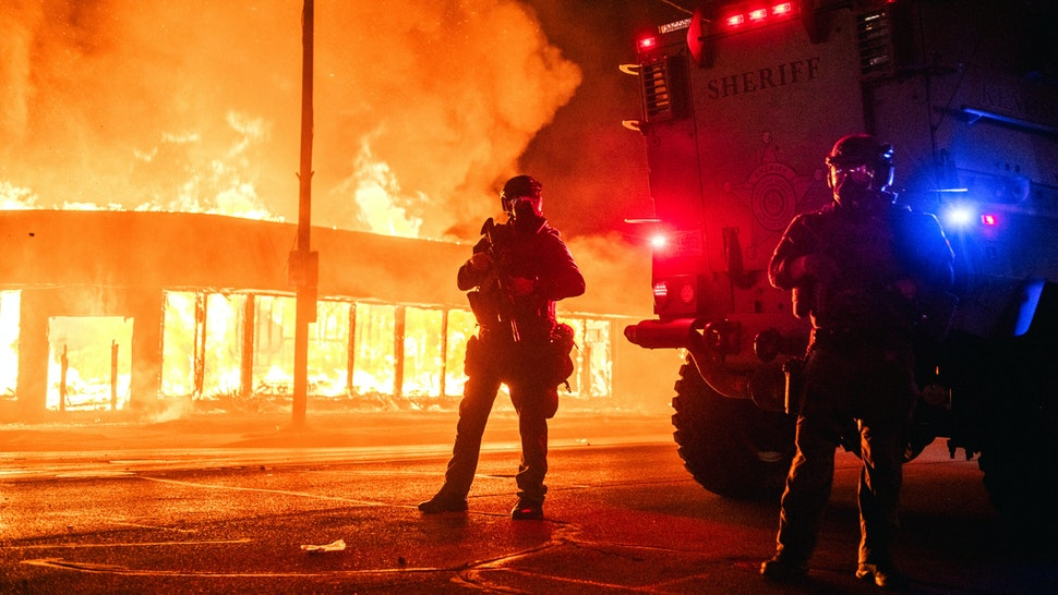 KENOSHA, WI - AUGUST 24: A police armored vehicle patrols an intersection on August 24, 2020 in Kenosha, Wisconsin. This is the second night of rioting after the shooting of Jacob Blake, 29, on August 23. Blake was shot multiple times in the back by Wisconsin police officers after attempting to enter into the drivers side of a vehicle.