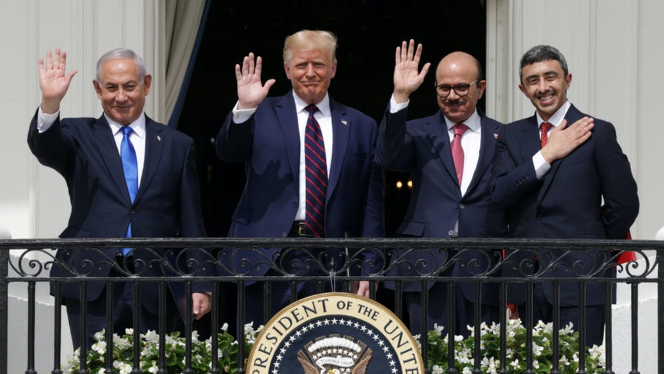 Prime Minister of Israel Benjamin Netanyahu, U.S. President Donald Trump, Foreign Affairs Minister of Bahrain Abdullatif bin Rashid Al Zayani, and Foreign Affairs Minister of the United Arab Emirates Abdullah bin Zayed bin Sultan Al Nahyan wave from the Truman Balcony of the White House after the signing ceremony of the Abraham Accords on the South Lawn of the White House on September 15, 2020 in Washington, DC.