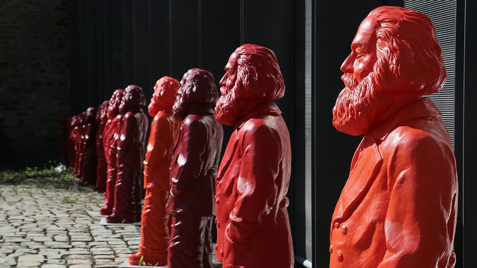 Some of the 500, one meter tall statues of German political thinker Karl Marx on display on May 5, 2013 in Trier, Germany.