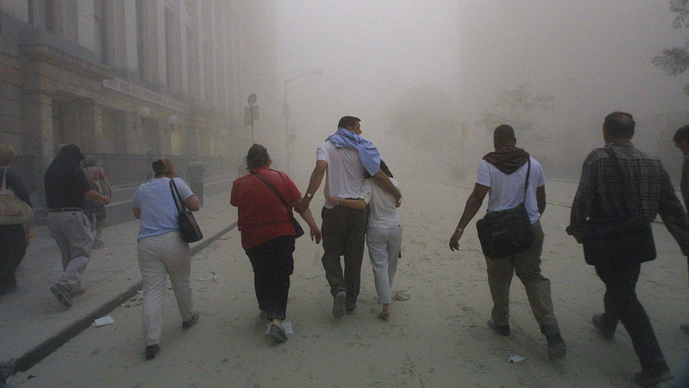 Civilians flee as a tower of the World Trade Center collapses September 11, 2001 after two airplanes slammed into the twin towers in an alleged terrorist attack.