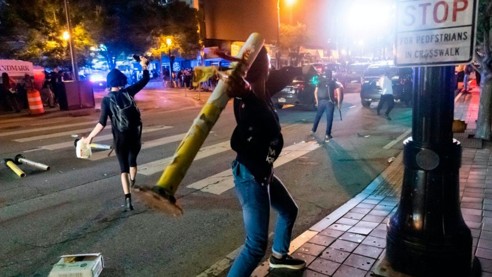 Protesters face off with police during rioting and protests in Atlanta on May 29, 2020.