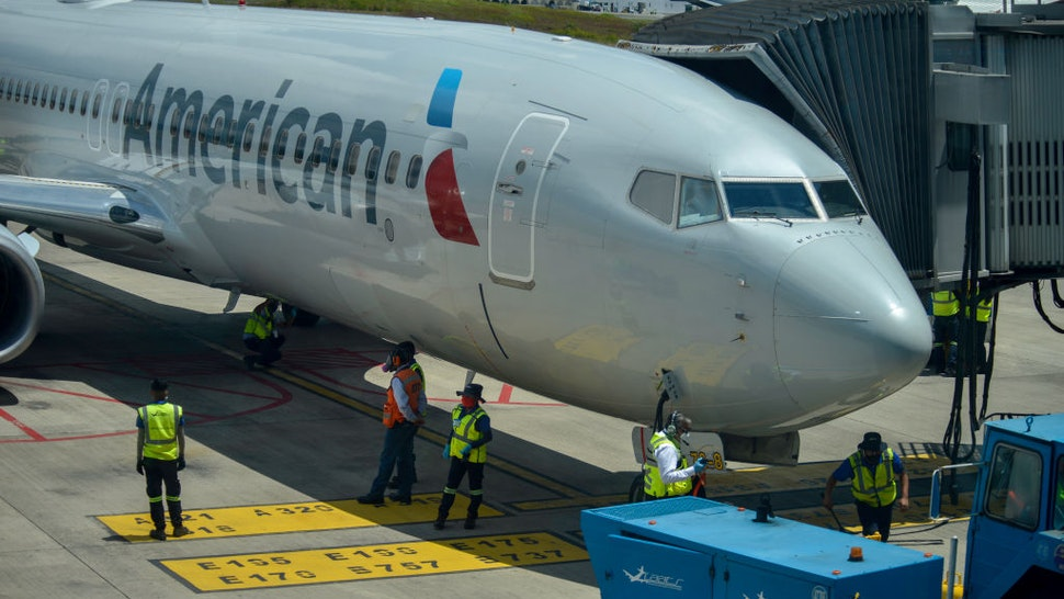 American Airlines employees check their plane after landing at La Aurora International Airport, in Guatemala City, Guatemala on Friday, September 18. The airport opens its international flight operations, and remained closed for 6 months to prevent the spread of COVID-19. During the pandemic, 84,344 people were infected and 3,076 died. (Photo by Deccio Serrano/NurPhoto via Getty Images)