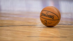 The official game ball sits on the court during the game between the Denver Nuggets and the LA Clippers at Pepsi Center on February 27, 2018 in Denver, Colorado.