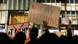 Dozens of anti-Donald Trump protesters stand along 5th Avenue in front of Trump Tower as New Yorkers react for a second night to the election of Trump as president of the United States on November 10, 2016 in New York City.