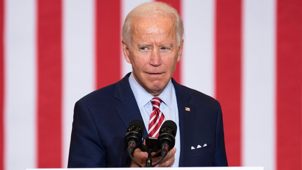 Democratic Presidential Candidate Joe Biden plays music from his cell phone as he participates in a Hispanic Heritage Month event at the Osceola Heritage Park in Kissimmee, Florida on September 15, 2020.