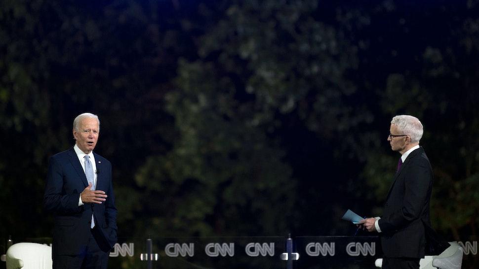 Democratic presidential candidate Joe Biden (L) speaks, alongside journalist Anderson Cooper, during a CNN drive-in Town Hall meeting in Scranton, Pennsylvania, on September 17, 2020.