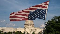 U.S. Capitol with upside U.S. flag