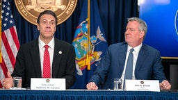"NEW YORK, NY - MARCH 2: New York state Gov. Andrew Cuomo and New York City Mayor Bill DeBlasio speak during a news conference on the first confirmed case of COVID-19 in New York on March 2, 2020 in New York City. A female health worker in her 30s who had traveled in Iran contracted the virus and is now isolated at home with symptoms of COVID-19, but is not in serious condition. Cuomo said in a statement that the patient ""has been in a controlled situation since arriving to New York."""