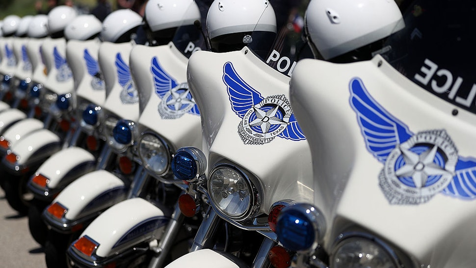 DALLAS, TX - JULY 14: Dallas police motorcycles line up outside of the funeral for slain Dallas police Sgt. Michael Smith at The Watermark Church on July 14, 2016 in Dallas, Texas. Dallas police Sgt. Michael Thomas was one of five Dallas police officers who were shot and killed by a sniper during a Black Lives Matter march in Dallas. (Photo by Justin Sullivan/Getty Images)