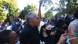 """ROCHESTER, NEW YORK - SEPTEMBER 03: Asa Adams yells at an unknown person after a disagreement about a vigil for Daniel Prude on September 03, 2020 in Rochester, New York. Prude died after being arrested on March 23 by Rochester police officers who had placed a """"spit hood"""" over his head and pinned him to the ground while restraining him. Mayor Lovely Warren announced today the suspension of seven officers involved in the arrest. (Photo by Michael M. Santiago/Getty Images)"""