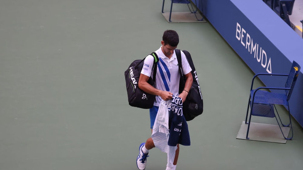 NEW YORK, NEW YORK - SEPTEMBER 06: Novak Djokovic of Serbia walks off the court after being defaulted due to inadvertently striking a lineswoman with a ball hit in frustration during his Men's Singles fourth round match against Pablo Carreno Busta of Spain on Day Seven of the 2020 US Open at the USTA Billie Jean King National Tennis Center on September 6, 2020 in the Queens borough of New York City