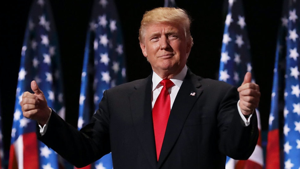 Republican presidential candidate Donald Trump gives two thumbs up to the crowd during the evening session on the fourth day of the Republican National Convention on July 21, 2016 at the Quicken Loans Arena in Cleveland, Ohio.