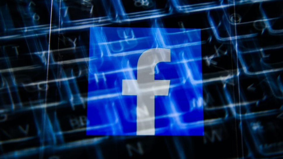 In this photo illustration a Facebook logo seen displayed on a smartphone with a laptop keyboard in the background. (Photo Illustration by Omar Marques/SOPA Images/LightRocket via Getty Images)