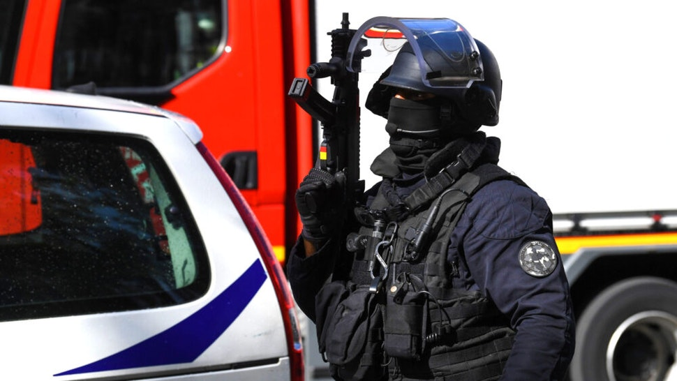 A French police intervention unit (GSO) officer secures the area after several people were injured near the former offices of the French satirical magazine Charlie Hebdo following an attack by a man wielding a knife in the capital Paris on September 25, 2020. - Four people were injured, two seriously, in a knife attack in Paris on September 25, 2020, near the former offices of French satirical magazine Charlie Hebdo, a source close to the investigation told AFP. Two of the victims were in a critical condition, the Paris police department said, adding two suspects were on the run. The stabbing came as a trial was underway in the capital for alleged accomplices of the authors of the January 2015 attack on the Charlie Hebdo weekly that claimed 12 lives.