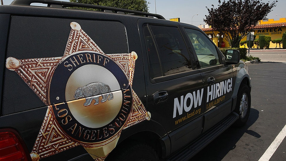 MAYWOOD, CA - JUNE 23: Los Angeles County sheriffs vehicle that advertises for recruits is parked in the parking lot of the Maywood police department as sheriffs deputies make plans to take over the facility on June 23, 2010 in Maywood, California. Facing a $450,000 budget deficit, the Maywood City Council approved the most drastic action yet of any California city to wrest control of its fiscal crisis by firing all its employees, disbanding its police department and contracting out its entire municipal operations to a neighboring city. County sheriffs will replace Maywood police officers but council members will remain on the payroll to set policy. (Photo by David McNew/Getty Images)