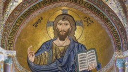 Close-up of Cefalu Cathedral with prominent Christ Pantocrator mosaic in the apse in Cefalu, Sicily, Italy
