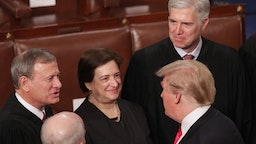 President Donald Trump greets Supreme Court Justices John Roberts, Elena Kagan, and Neil Gorsuch after the State of the Union address in the chamber of the U.S. House of Representatives at the U.S. Capitol Building on February 5, 2019 in Washington, DC.