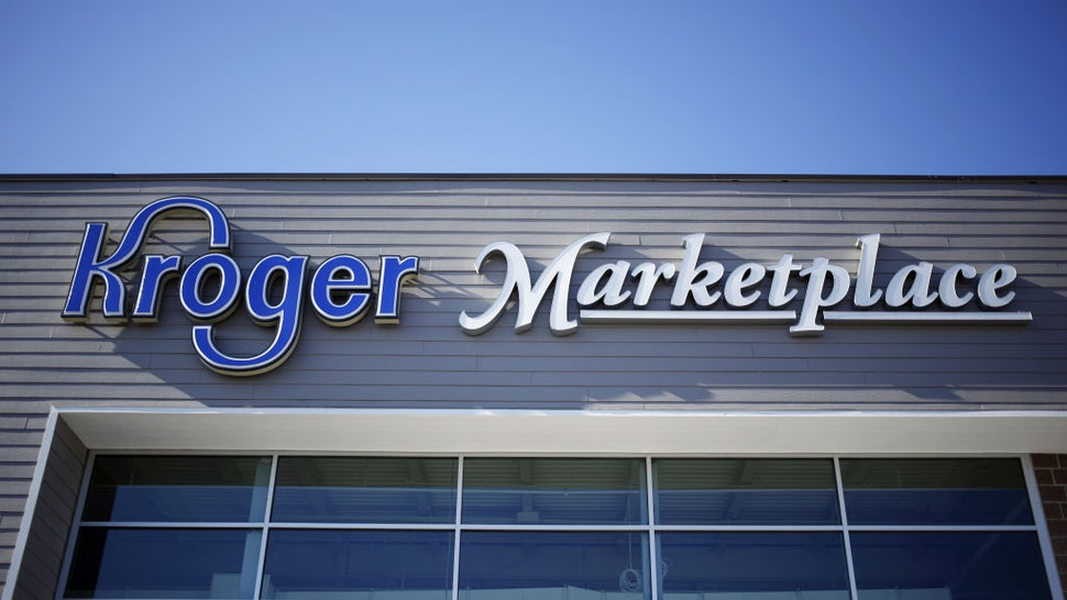 Signage is displayed outside a Kroger Co. supermarket in Louisville, Kentucky, U.S., on Tuesday, March 5, 2019.
