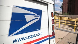 CHICAGO, ILLINOIS - AUGUST 15: A United States Postal Service (USPS) truck leaves a postal facility on August 15, 2019 in Chicago, Illinois. In its recent quarterly statement the USPS reported a loss of nearly $2.3 billion and a 3.2 percent decline in package deliveries, the first decline in nearly a decade. (Photo by Scott Olson/Getty Images)
