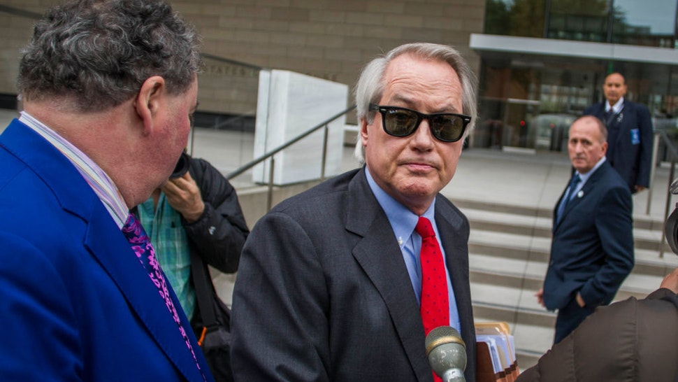 Attorneys L. Lin Wood (C) and Mark Stephen (L) speak to the media about their client, British rescue diver Vernon Unsworth (rear), as they arrive at US District Court on December 3, 2019 in Los Angeles, California.