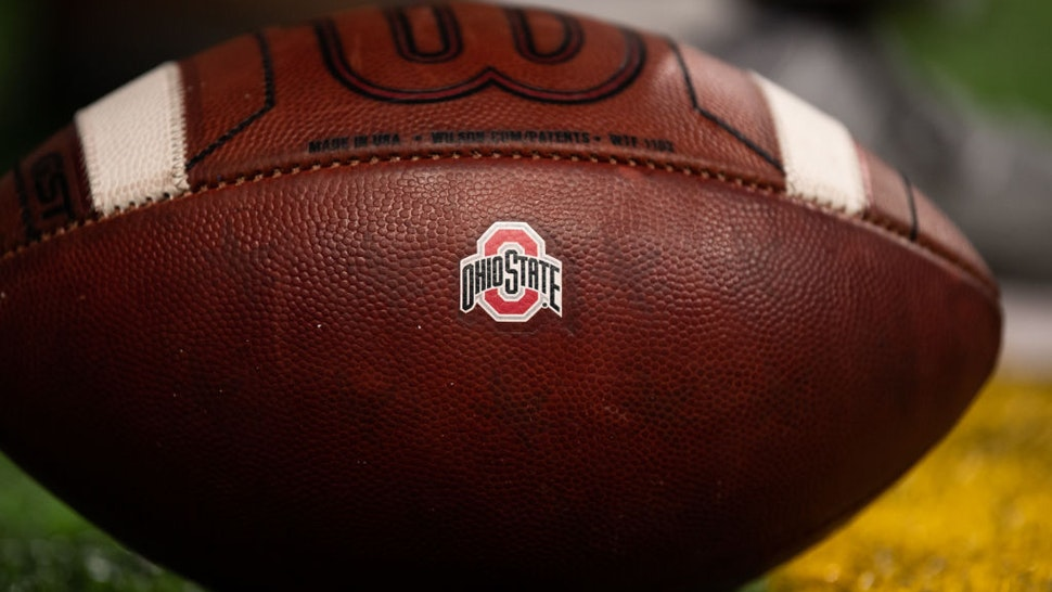 INDIANAPOLIS, IN - DECEMBER 07: A NCAA football with the Ohio State Buckeyes logo on it during the Big 10 Championship game between the Wisconsin Badgers and Ohio State Buckeyes on December 7, 2019, at Lucas Oil Stadium in Indianapolis, IN. (Photo by Zach Bolinger/Icon Sportswire via Getty Images)