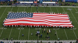 A general view of a large American Flag on the field prior to the National Football League game between the New York Giants and the Miami Dolphins on December 15, 2019 at MetLife Stadium in East Rutherford, NJ.