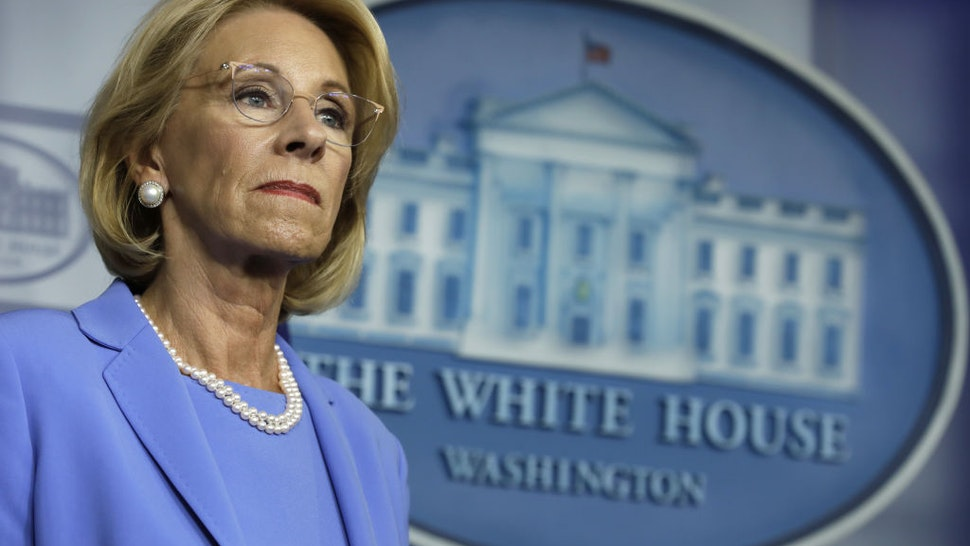 Betsy DeVos, U.S. secretary of education, listens during a Coronavirus Task Force news conference at the White House in Washington, D.C., U.S., on Friday, March 27, 2020.