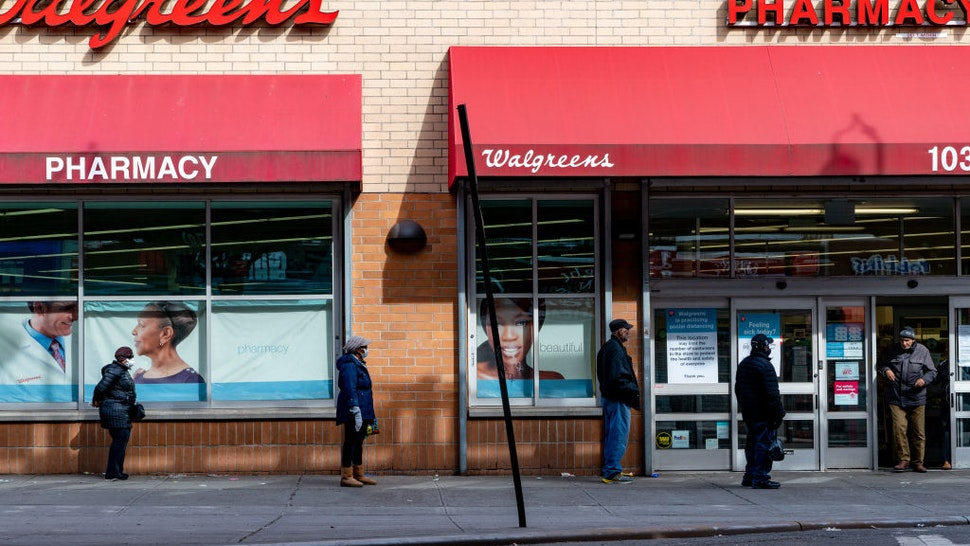 People stand in line outside of Walgreens on Westchester Avenue on April 14, 2020 in the Bronx borough of New York City.