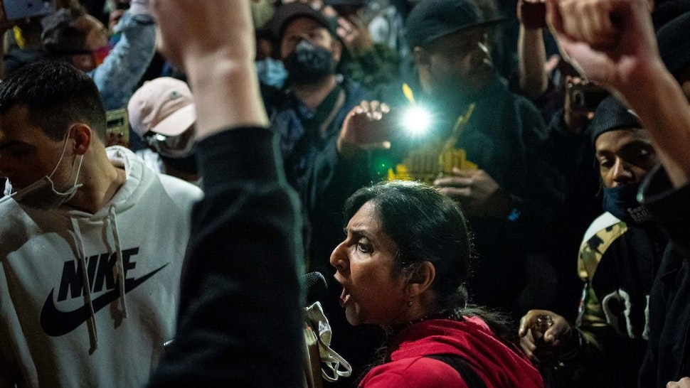 Seattle City Council member Kshama Sawant, a critic of Mayor Jenny Durkan and the Seattle Police Department, speaks as demonstrators hold a rally outside of the Seattle Police Departments East Precinct, which has been boarded up and protected by fencing, on June 8, 2020 in Seattle, Washington.