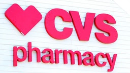 A sign on the side of the CVS Pharmacy on May 15, 2020 in Carver, Massachusetts. Nine CVS locations began providing coronavirus tests in Massachusetts, issuing self swab tests to people by appointment.