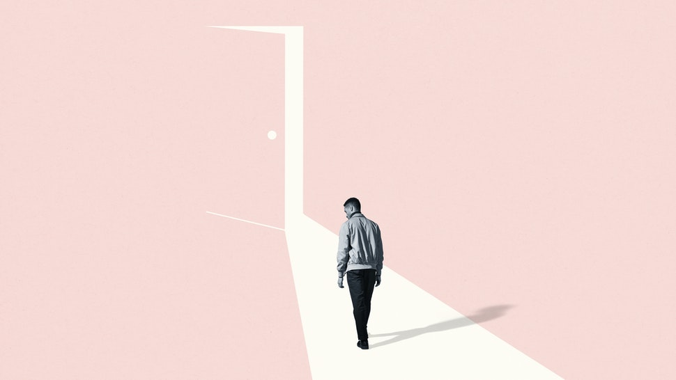 Sad young man walking towards ajar door - stock photo