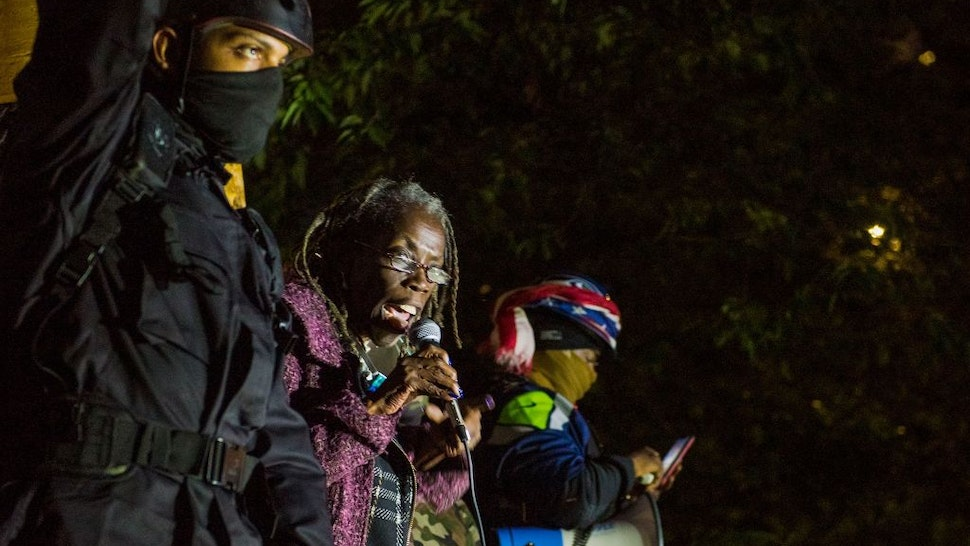 Portland City Commissioner Jo Ann Hardesty (C) addresses protesters as they take part in a rally against police brutality in Portland, Oregon late July 24, 2020