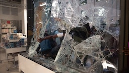 People break the glass of a Nordstrom store before stealing merchandise in downtown Minneapolis, US on August 26, 2020.