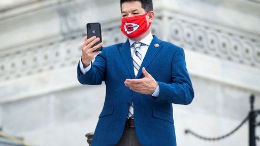 Rep. T.J. Cox, D-Calif., films a message outside the Capitol as the House voted on a bill to ban changes to U.S. Postal Service operations and provide $25 billion in funding on Saturday, August 22, 2020.