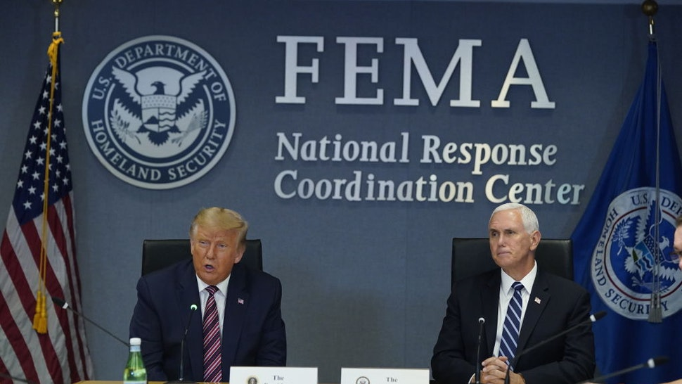 U.S. President Donald Trump speaks while Vice President Mike Pence, right, listens during a meeting at the Federal Emergency Management Agency (FEMA) headquarters in Washington, D.C., U.S., on Thursday, Aug. 27, 2020. Donald Trump visited FEMA to monitor Tropical Storm Laura's assault on the Gulf Coast -- hours before hes set to accept the GOP nomination for president.