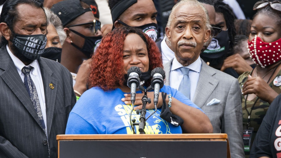 """Tamika Palmer reacts while speaking about her daughter Breonna Taylor, who police shot in her apartment in Kentucky, during the """"Get Your Knee Off Our Necks"""" March on Washington in Washington, D.C., U.S., on Friday, Aug. 28, 2020."""